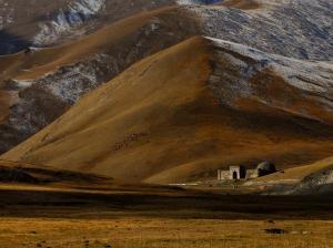 Caravan Sarayi Dwarfed by Surrounding Mountains near Tash Rabat, Kyrgyzstan