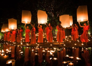 Monks releasing flying lanterns during Loy Krathong in Chiang Mai, Thailand