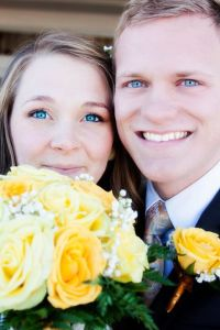 Newlyweds with bright eyes and glowing faces outside a Mormon temple